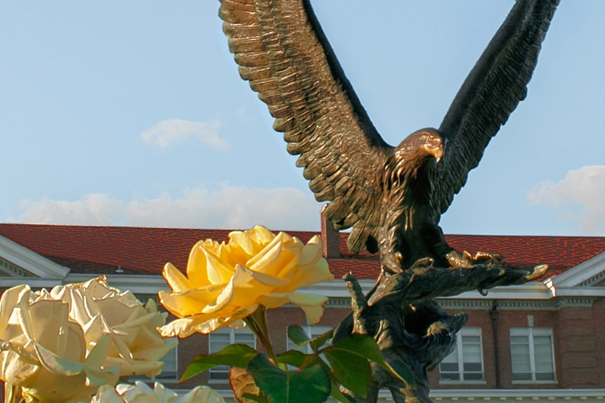 Roses in front of an eagle statue