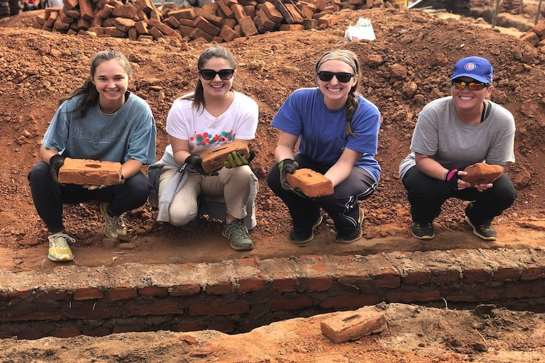 USM students have helped build a school in Africa.