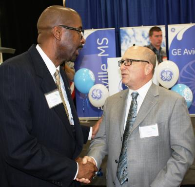 Southern Miss President Rodney Bennett greets GE Aviation CEO David Joyce during the grand opening of the company's facility in Ellisville Tuesday. (University Communications photo by David Tisdale)