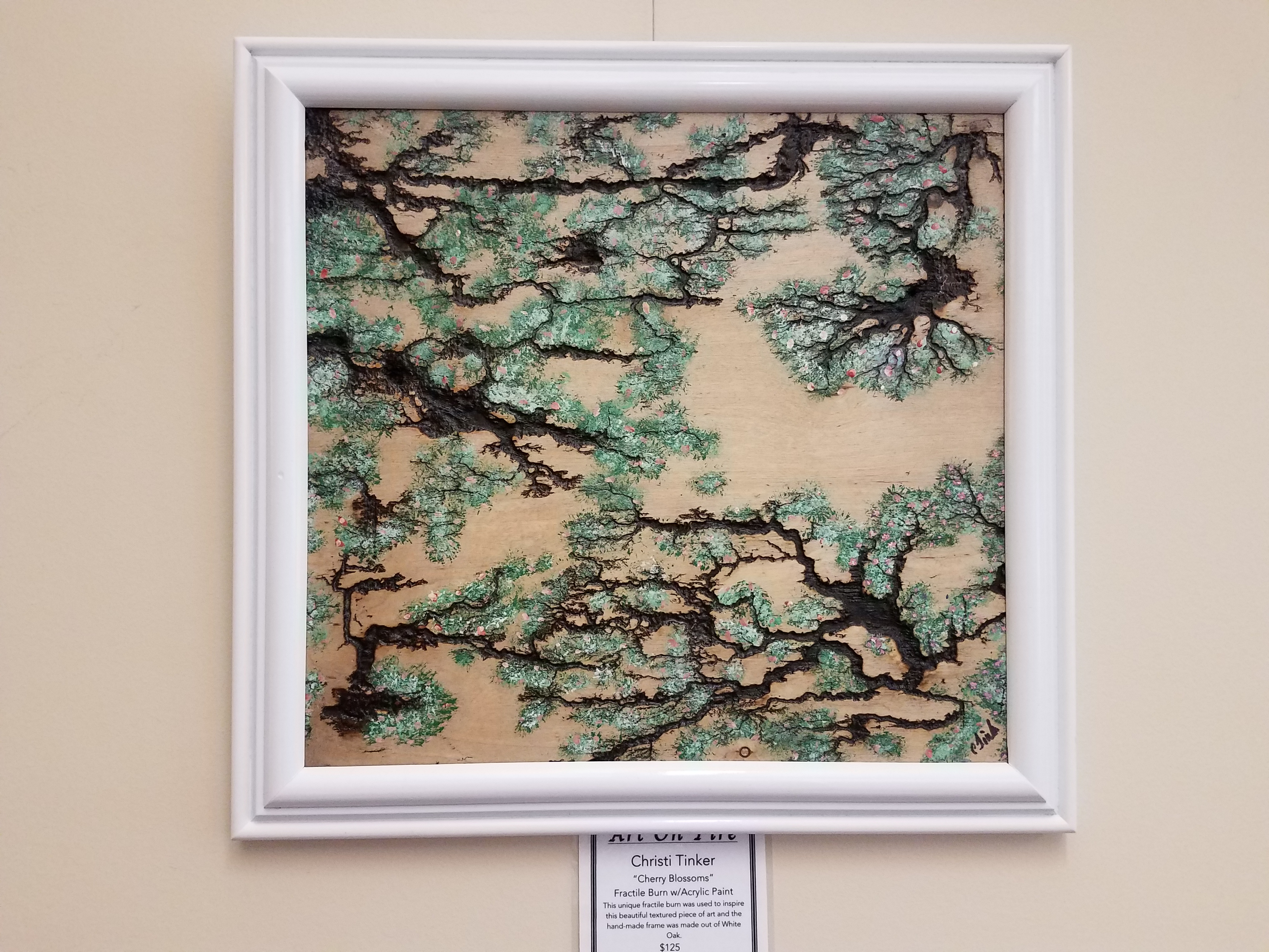 "Christi Tinker's ""Cherry Blossoms"" is on display for the USM Gulf Coast Library's ""Art on Fire"" exhibit."
