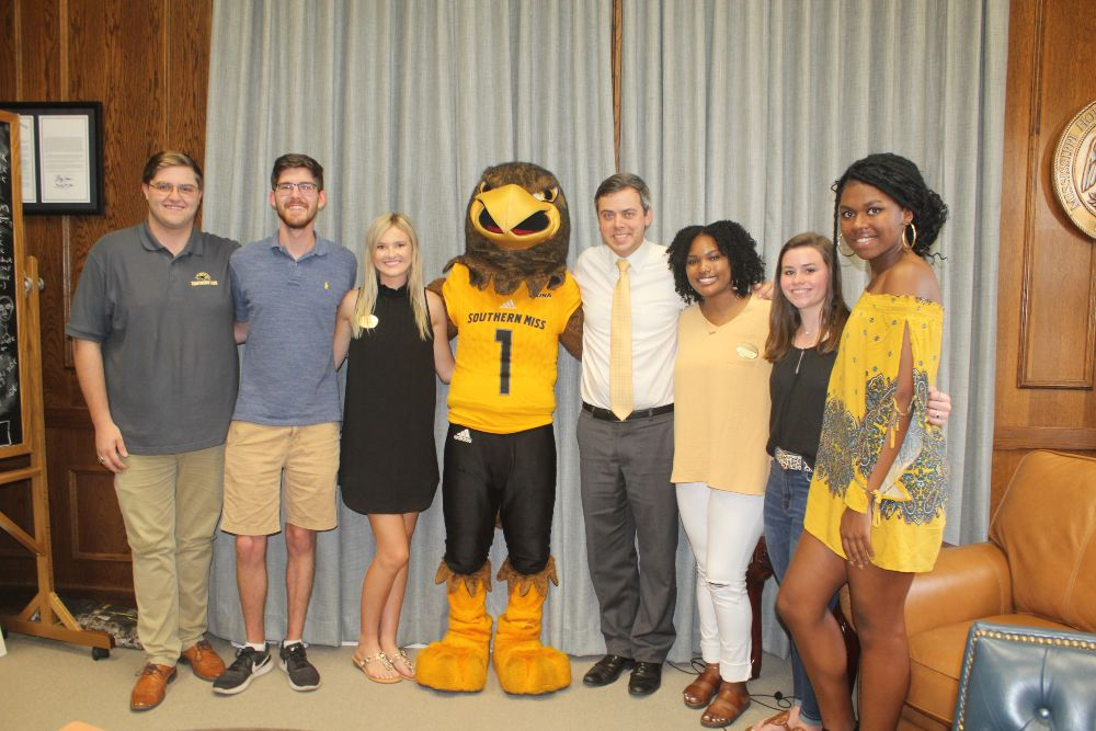 Hattiesburg Mayor Toby Barker, pictured here with USM mascot Seymour and student leaders in his office at City Hall, will serve as grand marshal of the school's 2019 homecoming parade. (Submitted photo)