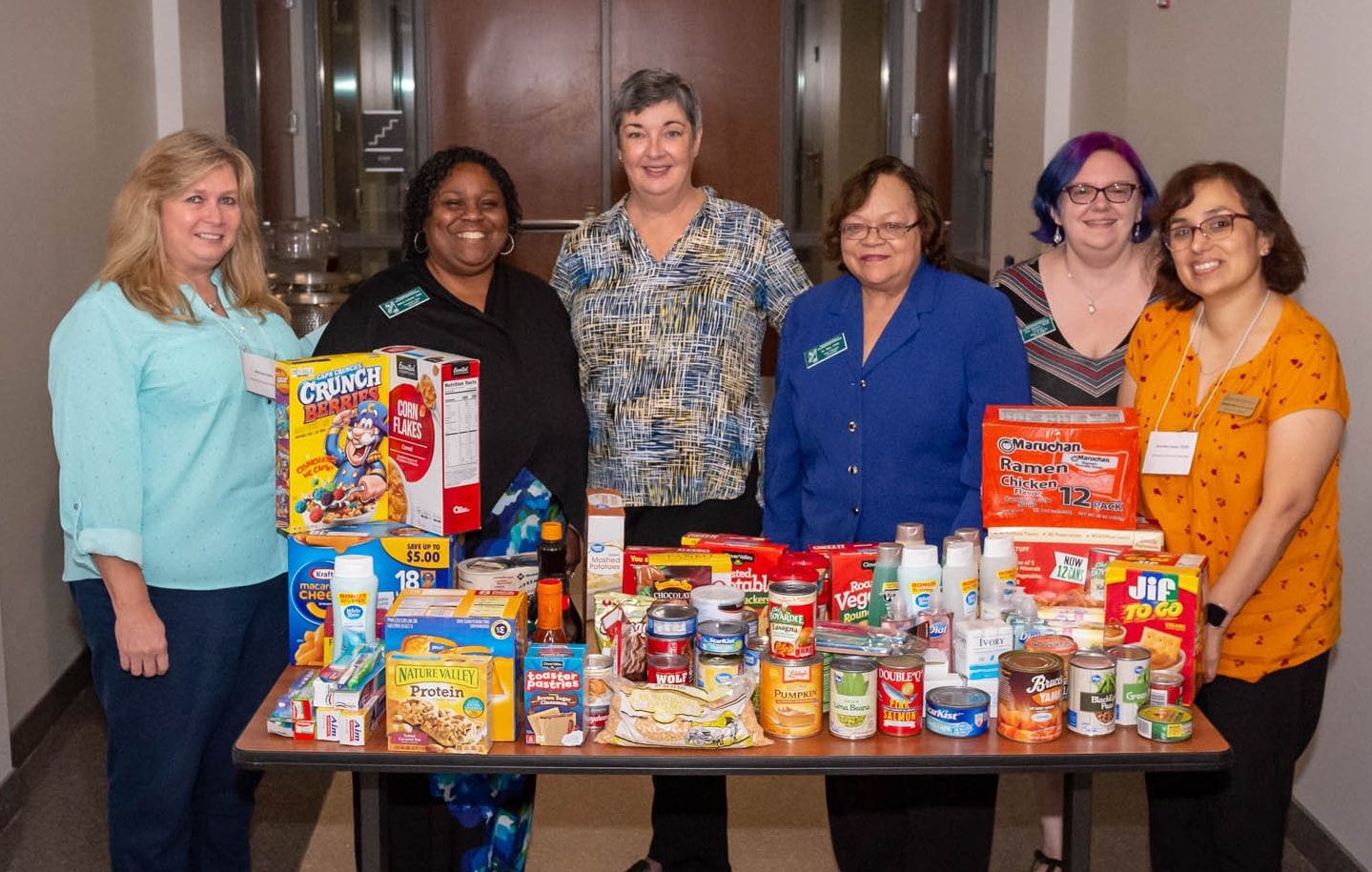 Dr. Tamara Hurst, center, a faculty member in The University of Southern Mississippi (USM) School of Social Work, accepted donations for the Eagle's Nest Pantry from members of the Mississippi Association of Educational Office Professionals (MAEOP) and the USM chapter of MAEOP, the USM Association of Office Professionals (USM AOP) on October 25th during the Mississippi Association of Educational Office Professional Development Seminar (MAEOP PDS).