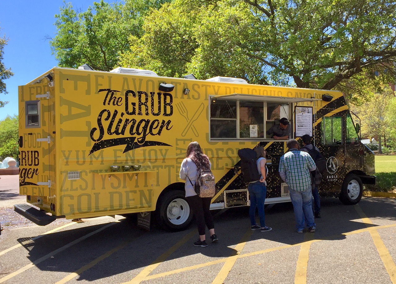 The Grub Slinger food truck serving food to students