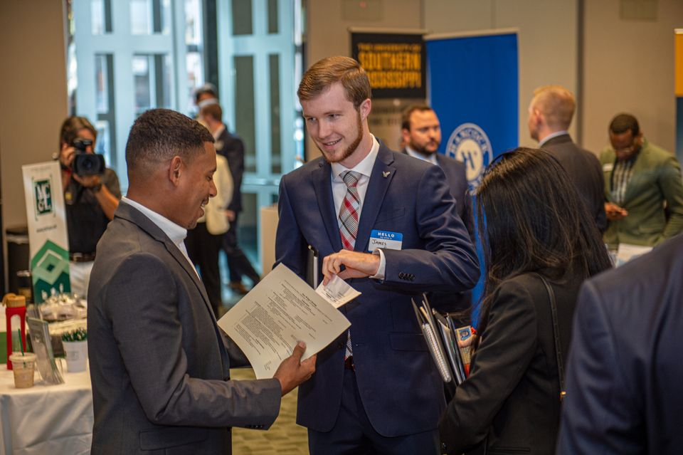Students meeting representatives of a firm