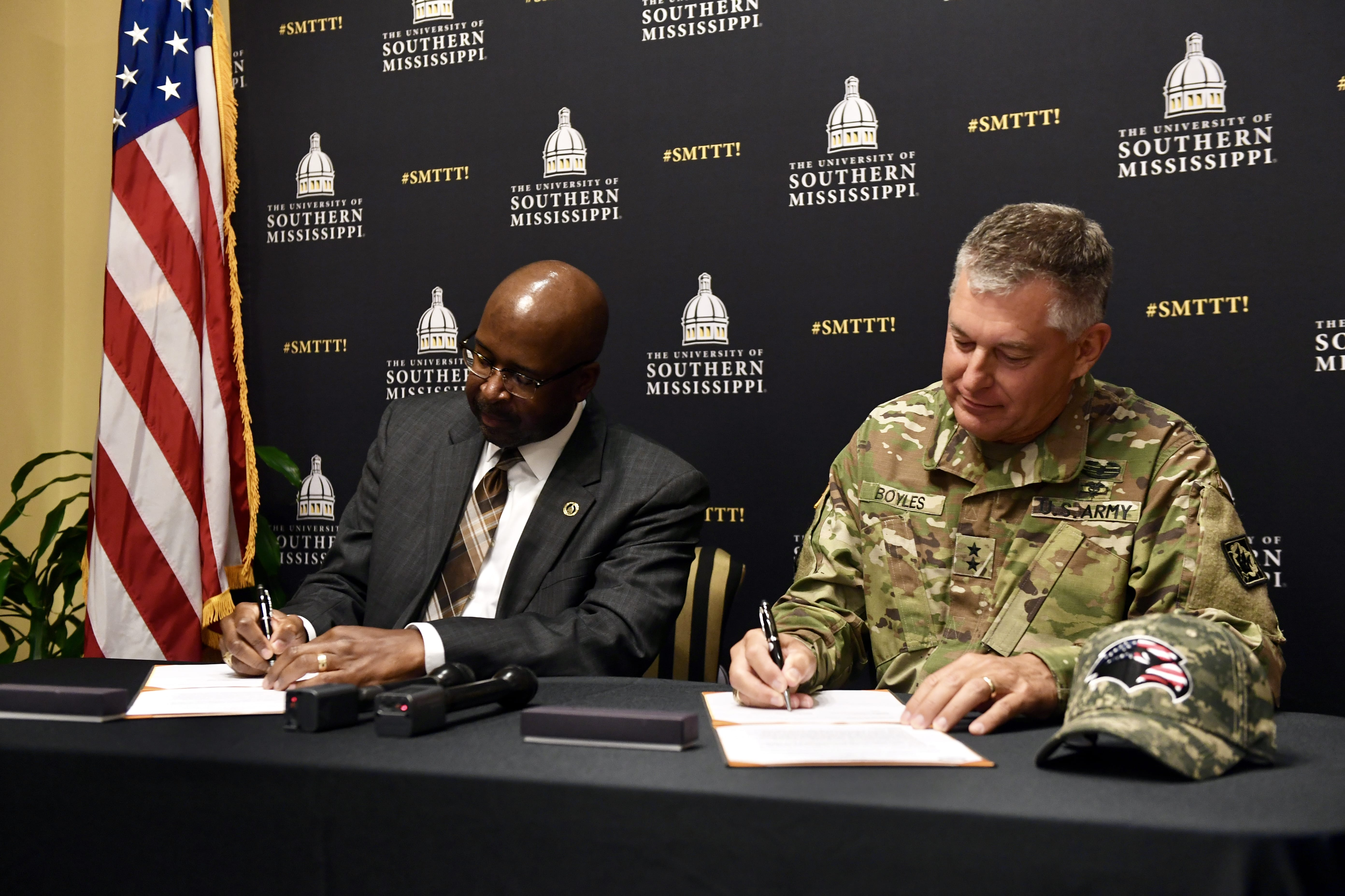 "USM President Rodney D. Bennett joined Maj. Gen. Janson D. ""Durr"" Boyles, Adjutant General of Mississippi, in signing a Memorandum of Understanding on Wednesday morning, outlining the two entities' commitment to the Golden Eagle Free Tuition Program."