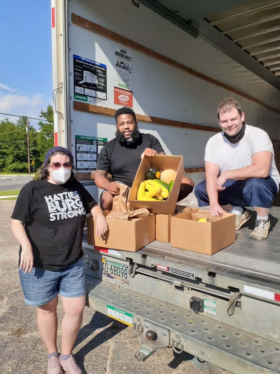 James Skinner, far right, a graduate student at USM, is helping coordinate a food relief effort in South Mississippi, along with other volunteers, to aid residents and their families adversely affected by the COVID-19 pandemic (Submitted photo)
