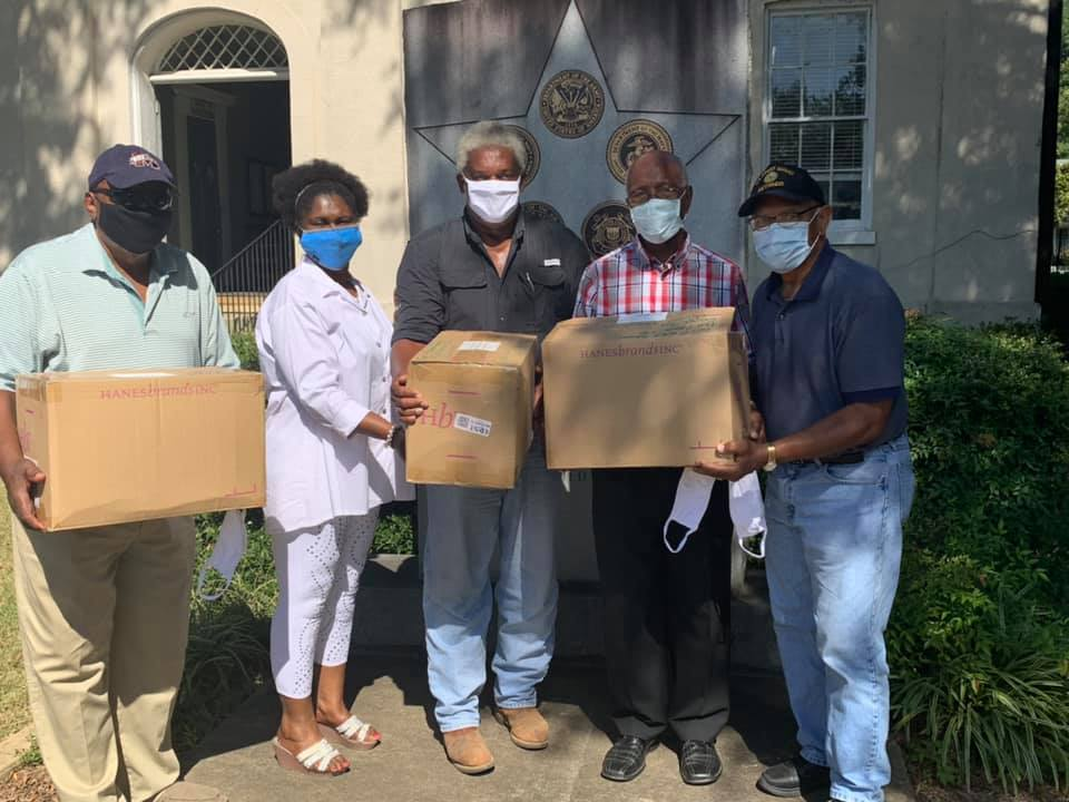 Community Health Advisors met with Freddie White-Johnson, second from left, at the Carroll County Courthouse this week to distribute free masks.