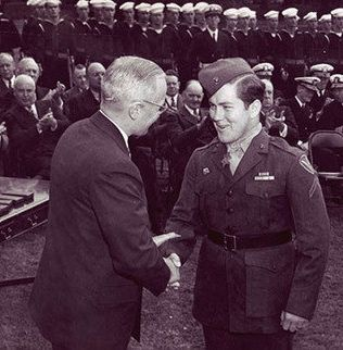 October 5, 1945 PFC Jack Lucas is awarded the Medal of Honor by President Harry