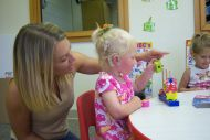 child learning with instructor
