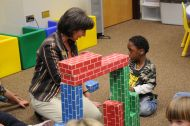 child playing with blocks in classroom