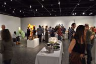 Students and Faculty enjoy the pieces on display at the 2015 Faculty Show