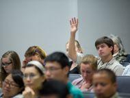 Participant asks question during Q&A session