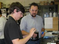 photograph of SEED student working with Dr. Wallace (right) in lab